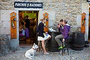 Locals at tapas bar, Pinchos Y Raciones, in cobbled street of Calle Del Canton in Santillana del Mar, Cantabria, Northern Spain
