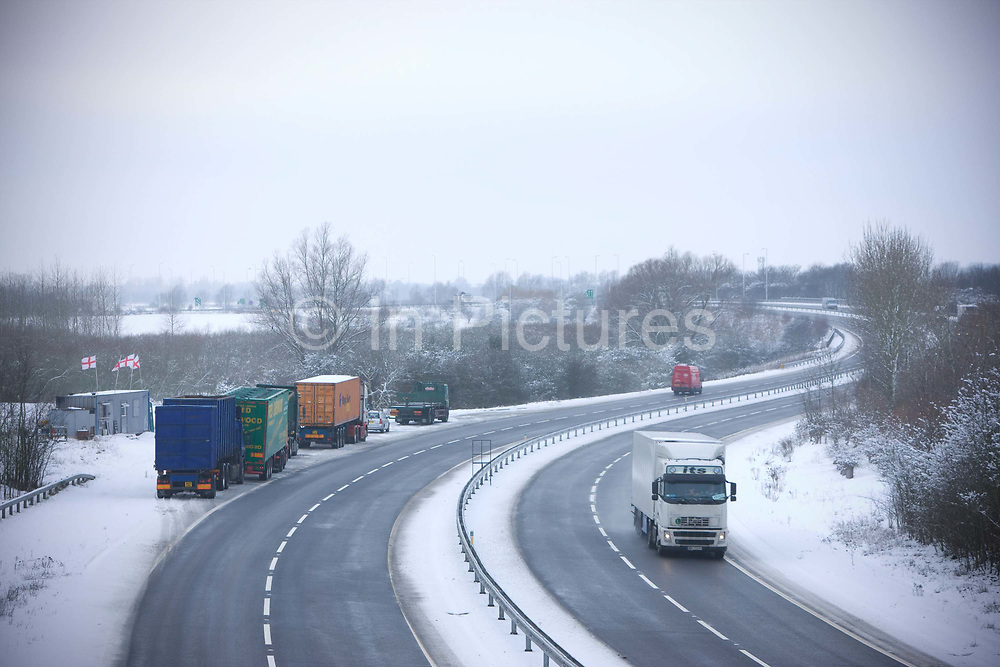 A wintry afternoon on the A12 with lorries parked at Vinnie's Diner, a transport cafe at a roadside layby on the 7th January 2010 in Inworth in the United Kingdom.