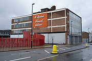 A hundred thousand welcomes sign outside Digbeth Coach Station in Birmingham city centre, which is virtually deserted under Coronavirus lockdown on a wet rainy afternoon on 28th April 2020 in Birmingham, England, United Kingdom. Britains second city has been in a state of redevelopment for some years now, but with many outdated architectural remnants still remaining, on a grey day, the urban landscape appears as if frozen in time. Coronavirus or Covid-19 is a new respiratory illness that has not previously been seen in humans. While much or Europe has been placed into lockdown, the UK government has put in place more stringent rules as part of their long term strategy, and in particular social distancing.