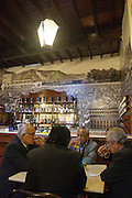 Business men drinking beer at El Queirolo pisco bar in Lima, Perú.