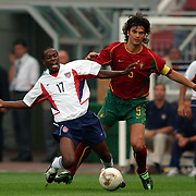 USA's DaMarcus Beasley tackled by Portugal's Fernando Couto