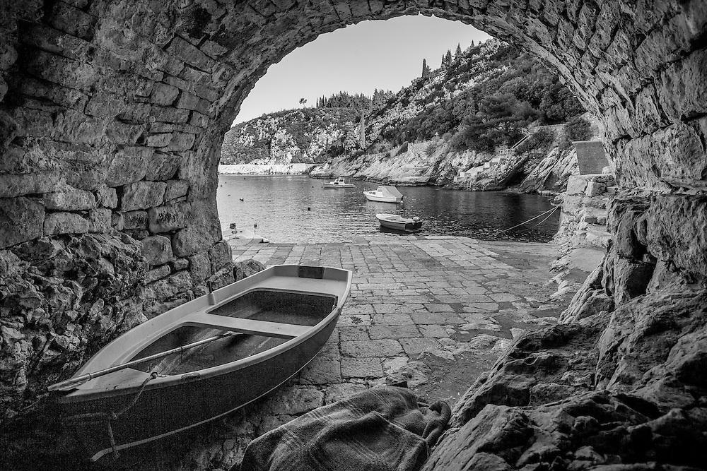 Trsteno, Croatia archway and harbor - black and white photo