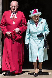 Windsor, UK. 21st April 2019. The Queen leaves St George's Chapel in Windsor Castle with the Dean of Windsor, the Rt Revd David Conner KCVO, after attending the Easter Sunday service.