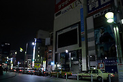 Large TV screens on Studio Alta in Shinjuku is turned off to  save electricity after a magnitude 9 earthquake and large tsunami hit the Tohoku region of north east Japan  on March 11th killing nearly 20,000 people and causing massive destruction along the whole coast, and a melt-down at the Fukushima Daichi nuclear power station. Tokyo, Japan March 15th 2011