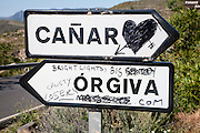 Graffiti on road signs for Orgiva and Canar, Alpujarra area, Granada province, Spain