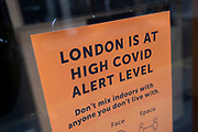 Londonis at high Covid alert level sign in a shop window as Londoners await the imminent end of the second coronavirus national lockdown before the capital enters tier two in the new three tier system on 1st December 2020 in London, United Kingdom. Non essential shops will be allowed to reopen as of 2nd December while in other areas of the country, controversially, they will have to remain closed.