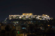 The Acropolis lit up at night, a UNESCO World Heritage site in central Athens, Greece.