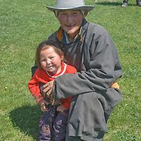 MONGOLIA, Darhad Valley.  Herder and grandchild.
