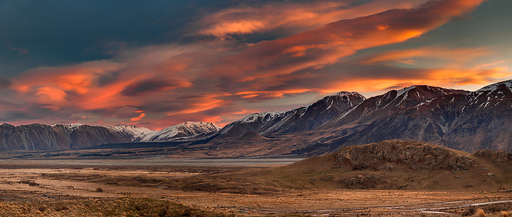 Windclouds at sunset, Rangitata river valley, panorama from Mt Sunday (Edoras village, Kingdom of Rohan in Lord of the Rings) near Mt Potts Station looking across river to Mesopotamia Station, Canterbury, New Zealand