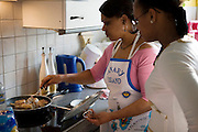 Maria Natercia Lopes-Furtado  and  Melody, in the kitchen of their home in the Grand Duchy of Luxembourg. The image is part of a collection of images and documentation for Hungry Planet 2, a continuation of work done after publication of the book project Hungry Planet: What the World Eats.