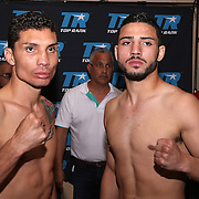 Claudionei Lacerda (L) and Julian Rodriguez is seen during weigh ins for the Top Rank boxing event at Osceola Heritage Park in Kissimmee, Florida on September 21, 2016.