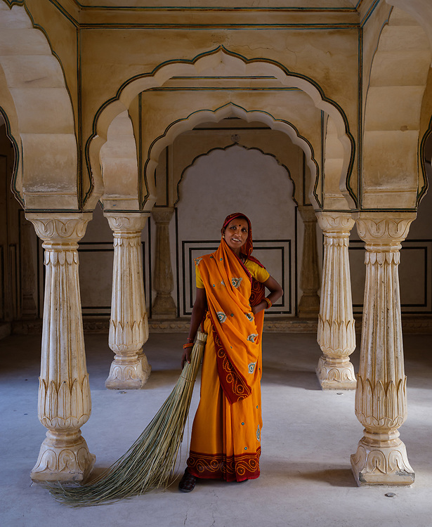 JAIPUR, INDIA - CIRCA NOVEMBER 2018: Indian woman in Amber Fort. Jaipur is the capital and the largest city of the Indian state of Rajasthan. Jaipur is also known as the Pink City, due to the dominant color scheme of its buildings and a popular tourist destination.