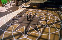 Executives walking through a courtyard at the MCI Building, Englewood, Colorado USA