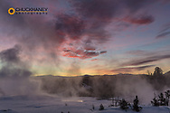 Briilant sunrise clouds over Mammoth Hot Springs in Yellowstone National Park, Wyoming, USA
