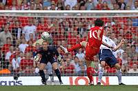 Photo: Henry Browne.<br /> Wales v England. FIFA World Cup Qualifying match.<br /> 03/09/2005.<br /> Simon Davies of Wales has a shot that goes wide.