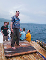 Professor Hinrich Kaiser and students Scott Heacox, Luis Lemos, Caitlin Sanchez, and Jester Ceballos (l to r) on the deck of a boat crossing the Wetar Strait from Dili to Atauro Island, Timor-Leste (East Timor)
