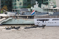 © Licensed to London News Pictures. 23/10/2018. London, UK. Dutch Royal Netherlands Marines in RIB's alongside HMS Belfast and HNLMS Zeeland during a rehearsal for a display tomorrow when the Royal Marines and Royal Netherlands Marines will stage a joint on water capability demonstration with blank ammunition. As part of the Dutch state visit, King Willem-Alexander and Queen Máxima will attend the Dutch ship HNLMS Zeeland, which is anchored next to HMS Belfast. They will join The Duke of Kent on board and will be given a 10 minute display of the Royal Marines and Royal Netherlands Marines staging a joint on water capability demonstration.Photo credit: Vickie Flores/LNP