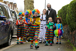 © Licensed to London News Pictures. 10/03/2020. London, UK. Members of the Jewish community celebrate the festival of Purim in Stamford Hill, north London. Purim is one of the most entertaining Jewish holidays. It commemorates the time when the Jewish people living in Persia were saved from massacre by Haman. It is customary to hold carnival-like celebrations on Purim. Stamford Hill in north London has the largest concentration of ultra-orthodox Charedi Hasidic Jews in Europe. Photo credit: Dinendra Haria/LNP