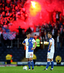Blackburn Rovers players react after conceding as Burnley fans let off a flare behind - Mandatory by-line: Matt McNulty/JMP - 23/08/2017 - FOOTBALL - Ewood Park - Blackburn, England - Blackburn Rovers v Burnley - Carabao Cup - Second Round