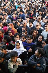 Multi racial crowd of people enjoying music at the Nottingham Mela,