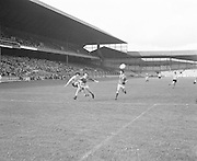 Antrim jumps into tackle Mayo as the ball comes towards them during the Antrim v Mayo All Ireland Minor Gaelic Football Final in Croke Park on the 8th of September 1974.