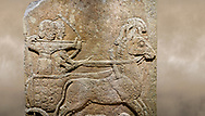 Photo of Hittite relief sculpted orthostat stone panel of Long Wall Limestone, Karkamıs, (Kargamıs), Carchemish (Karkemish), 900 - 700 B.C. Anatolian Civilisations Museum, Ankara, Turkey.<br /> <br /> Chariot. One of the two figures in the chariot holds the horse's headstall while the other throws arrows. There is a naked enemy with an arrow in his hip lying face down under the horse's feet It is thought that this figure is depicted smaller than the other figures since it is an enemy soldier. The lower part of the orthostat is decorated with braiding motifs. <br /> <br /> On a brown art background. .<br />  <br /> If you prefer to buy from our ALAMY STOCK LIBRARY page at https://www.alamy.com/portfolio/paul-williams-funkystock/hittite-art-antiquities.html  - Type  Karkamıs in LOWER SEARCH WITHIN GALLERY box. Refine search by adding background colour, place, museum etc.<br /> <br /> Visit our HITTITE PHOTO COLLECTIONS for more photos to download or buy as wall art prints https://funkystock.photoshelter.com/gallery-collection/The-Hittites-Art-Artefacts-Antiquities-Historic-Sites-Pictures-Images-of/C0000NUBSMhSc3Oo