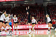 The USD women's volleyball team celebrates a point against Georgia Tech in the National Invitational Volleyball Championship game on Tuesday, Dec. 17, 2019, at the Sanford Coyote Sports Center in Vermillion.