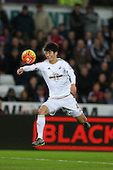 Ki Sung-Yueng of Swansea city in action. Barclays Premier league match, Swansea city v West Bromwich Albion at the Liberty Stadium in Swansea, South Wales  on Boxing Day Saturday 26th December 2015.<br /> pic by  Andrew Orchard, Andrew Orchard sports photography.