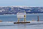 Port of Homer Deep Water Dock Sign on the Homer Spit during the winter.