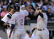 CHICAGO - JUNE 05:  Mark DeRosa #7 of the Cleveland Indians is greeted at home plate by Ben Francisco #12 after DeRosa hit a three run home run in the third inning against the Chicago White Sox on June 5, 2009 at U.S. Cellular Field in Chicago, Illinois.  The Indians defeated the White Sox 6-0.  (Photo by Ron Vesely)