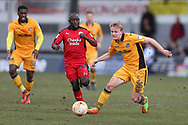 Alex Samuel of Newport county ® goes past Kaby Djalo of Crawley Town (c). EFL Skybet football league two match, Newport county v Crawley Town at Rodney Parade in Newport, South Wales on Saturday 1st April 2017.<br /> pic by Andrew Orchard, Andrew Orchard sports photography.