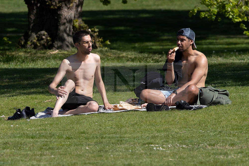 © Licensed to London News Pictures. 22/04/2020. London, UK. Members of the public enjoy a picnic as they sunbathe in Greenwich Park. Temperatures are set to rise throughout the rest of the week. Photo credit: George Cracknell Wright/LNP
