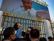 30 NOVEMBER 2017 - YANGON, MYANMAR: Boys on their parents' shoulders under an electronic billboard of the Pope releasing a dove during the Papal Mass at St. Mary's Cathedral in Yangon. Thursday's mass was his last public appearance in Myanmar. From Myanmar the Pope went on to neighboring Bangladesh.    PHOTO BY JACK KURTZ