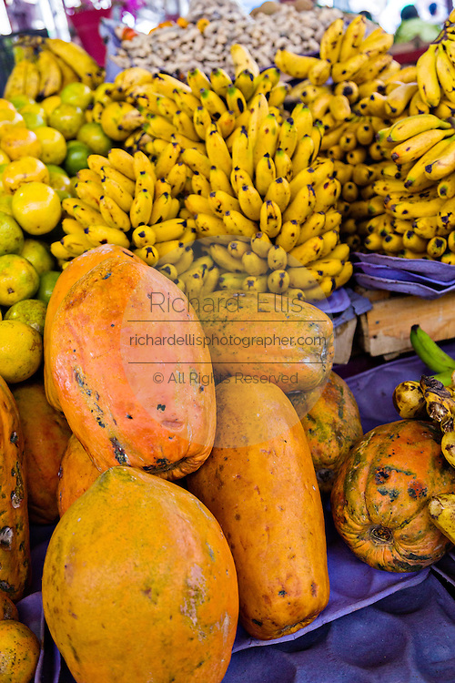 Papayas and bananas at a fresh fruit stand at the Sunday market in Tlacolula de Matamoros, Mexico. The regional street market draws thousands of sellers and shoppers from throughout the Valles Centrales de Oaxaca.