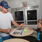 August 21, 2014, New Haven, CT:<br /> Andy Roddick signs autographs at the Legends Party during the Men's Legends Event on day seven of the 2014 Connecticut Open at the Yale University Tennis Center in New Haven, Connecticut Thursday, August 21, 2014.<br /> (Photo by Billie Weiss/Connecticut Open)