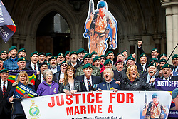© Licensed to London News Pictures. 24/03/2017. London, UK. Former members of armed forces wait for Sergeant Alexander Blackman's sentencing outside the Royal Courts of Justice in London. The decision is delayed until next Tuesday. Also known as Marine A, Sgt Blackman's life sentence was reduced to manslaughter for killing a wounded Taliban fighter in Afghanistan in 2011. Photo credit: Tolga Akmen/LNP