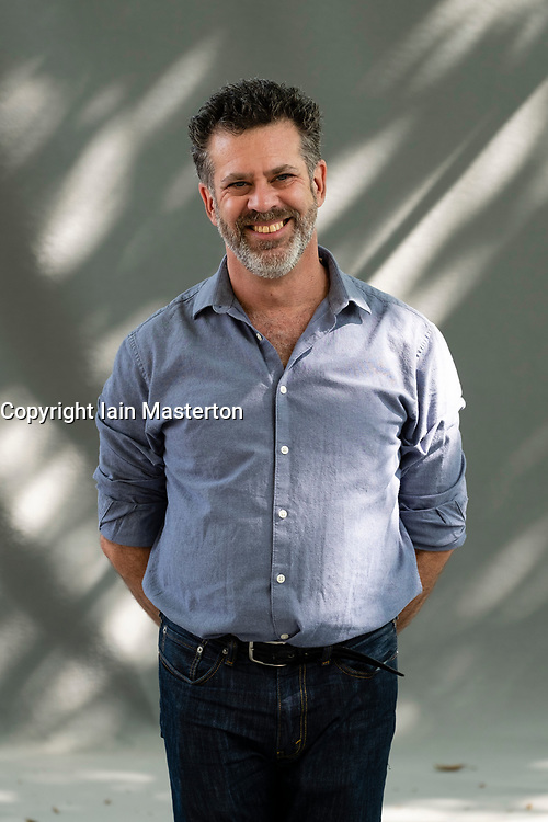 """Edinburgh, Scotland, UK; 15 August, 2018. Pictured;  Author Michael Redhill. Redhill's Giller prize-winning novel """"Bellevue Square"""" follows Jean a bookshop owner in downtown Toronto whose customers begin claiming they're seeing her doppelgänger."""