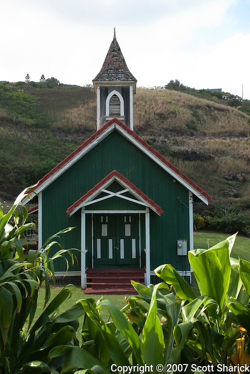 An old small wooden green church long the north coast of Maui.