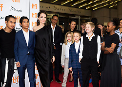 """Director and Actress Angelina Jolie, third left, poses for photographs with her six children on the red carpet for the movie """"First They Killed My Father"""" during the 2017 Toronto International Film Festival in Toronto, ON, Canada, on Monday, September 11, 2017. Photo by Nathan Denette/CP/ABACAPRESS.COM"""