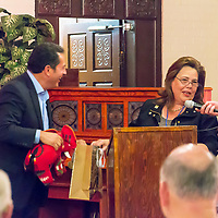 State Rep. Patricia Lundstrom gives Lt. Governor John Sanchez  one of her signature Pendleton Blanket Elephants at the annual GGEDC Business Retention and Expansion Luncheon, Monday.