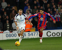 Photo: Kevin Poolman.<br />Crystal Palace v Colchester United. Coca Cola Championship. 09/12/2006. Karl Duguid of Colchester gets away from Palace player Jobi McAnuff.