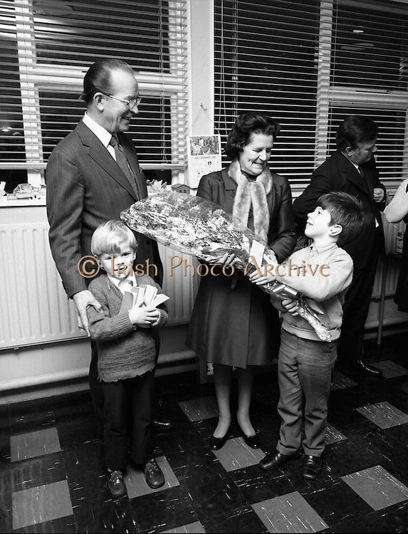 Jack Cruise at St Joseph's School for the Deaf..1972..19.11.1972..11.19.1972..19th November 1972..A charity walk, organised by the school committee, to aid the fund raising for a new swimming pool in St Josephs School for the Deaf took place yesterday..Jack Cruise,the comedian,presented tickets for his Christmas pantomime,at The Olympia, to all those who took part in the walk...Brendan Coyne,the youngest pupil at the school (tickets in hand) and Jimmy Hoey another pupil are pictured presenting a bouquet to Mrs Jack Cruise accompanied by her husband Jack Cruise
