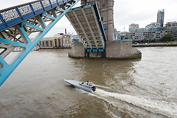 © Licensed to London News Pictures. 05/09/2016. LONDON, UK.  Bladerunner passing under Tower Bridge on the River Thames. The Royal Navy test out Bladerunner, their new prototype high speed drone speedboat on the River Thames in London this afternoon ahead of a major exercise. It is part of the Royal Navy's Unmanned Arrior program, which seeks to find an edge in the field of naval combat.  Photo credit: Vickie Flores/LNP