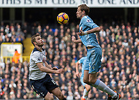 Football - 2016 / 2017 Premier League - Tottenham Hotspur vs. Stoke City<br /> <br /> Peter Crouch of Stoke City brings the ball under control with his chest as Eric Dier of Tottenham  watches on at White Hart Lane.<br /> <br /> COLORSPORT/DANIEL BEARHAM