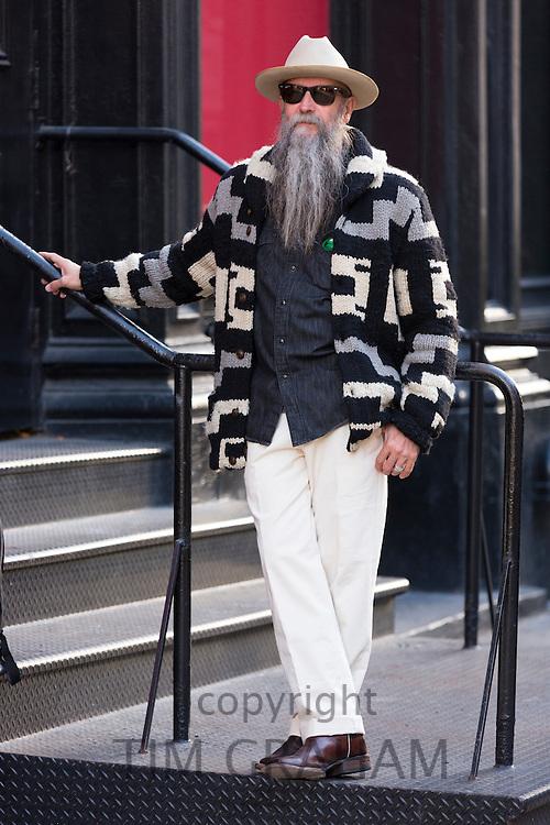 Male sartorial elegance men's co-ordinates fashion and shades worn by stylish man with long grey beard, Soho, New York, USA
