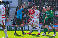 Kieran Sadlier of Doncaster Rovers (22) is booked and receives a caution and a yellow card for simulation during the EFL Sky Bet League 1 match between Doncaster Rovers and Coventry City at the Keepmoat Stadium, Doncaster, England on 4 May 2019.