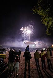 Villagers watching a firework display during Bastille day celebrations in the village of Neuwiller-les-Saverne, Alsace France.<br /> <br /> (c) Andrew Wilson   Edinburgh Elite media