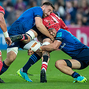 DUBLIN, IRELAND: October 16:  Blade Thomson #8 of Scarlets is tackled by Jack Conan #8 of Leinster and Josh van der Flier #7 of Leinster during the Leinster V Scarlets, United Rugby Championship match at RDS Arena on October 16th, 2021 in Dublin, Ireland. (Photo by Tim Clayton/Corbis via Getty Images)