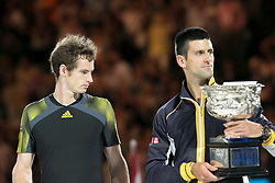 © Licensed to London News Pictures. 27/01/2013. Melbourne Park, Australia. Andy Murray looks at Novak Djokovic holding the winners trophy during the Mens Final between Novak Djokovic and Andy Murray of the Australian Open. Photo credit : Asanka Brendon Ratnayake/LNP