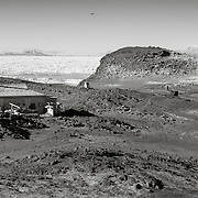 """Shackleton's Cape Royds """"Nimrod"""" hut, with the Adelie Penguin colony"""